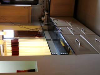 Apartment kitchen by renu soni interior design