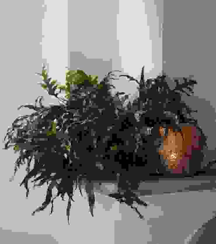 Angolo camino Sala da pranzo in stile classico di Tiziano Codiferro - Master Gardener Classico