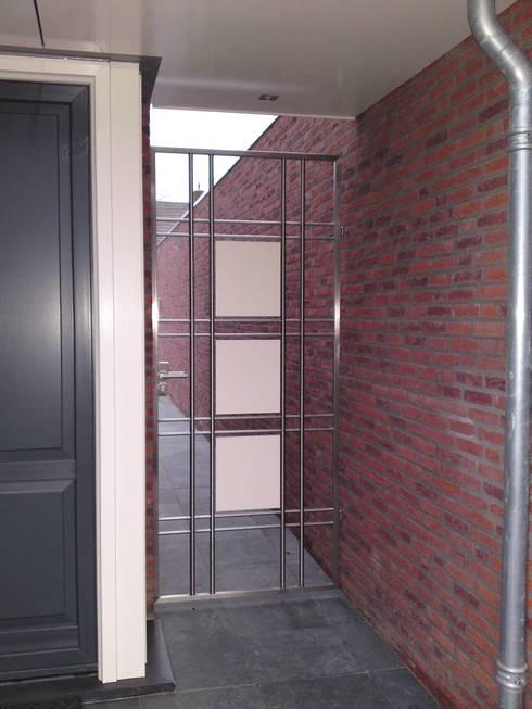 Rvs trapleuningen balustrades hekwerken en poorten door kouwenbergh machinefabriek b v homify - Tuin oprit plaat ...