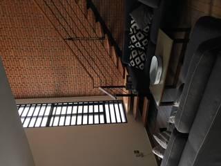 Casa Chichenitza : Salas de estilo moderno por Urbánica Desarrollos S.A. de C.V.
