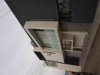 FACHADA  VISTA FRONTAL DERECHA: Casas de estilo  por Minimal architecture