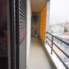 بلكونة أو شرفة تنفيذ Metamorfose Arquitetura e Urbanismo,