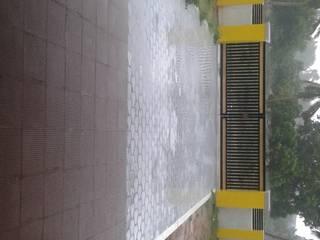front court yard:  Terrace by NISHA MIDAS CONSTRUCTION