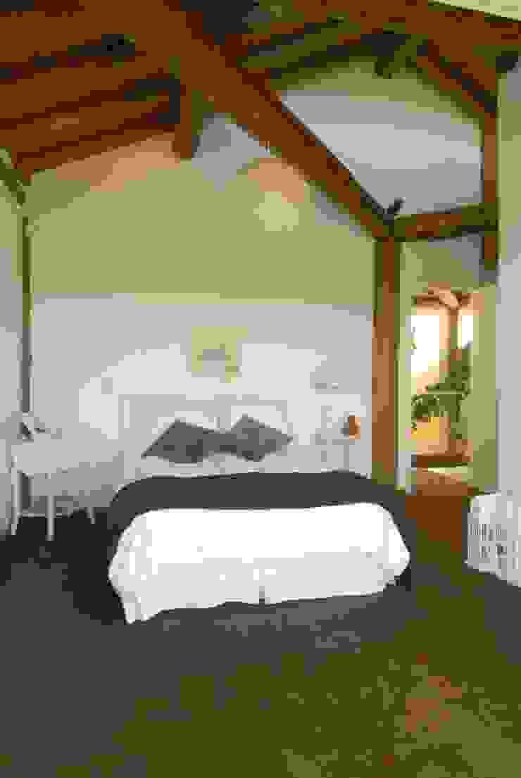 Rustikale Schlafzimmer von Carmen Saraiva Arquitetura Rustikal