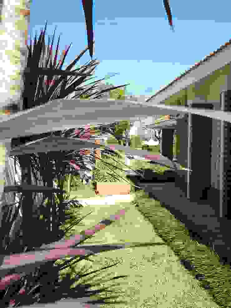 Eclectic style garden by milena oitana Eclectic