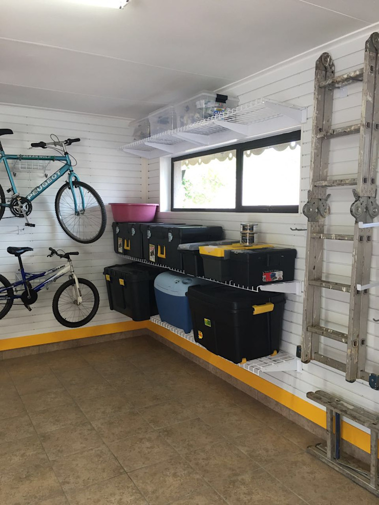 Storage Solutions for your Garage Industrial style garage/shed by MyGarage Industrial