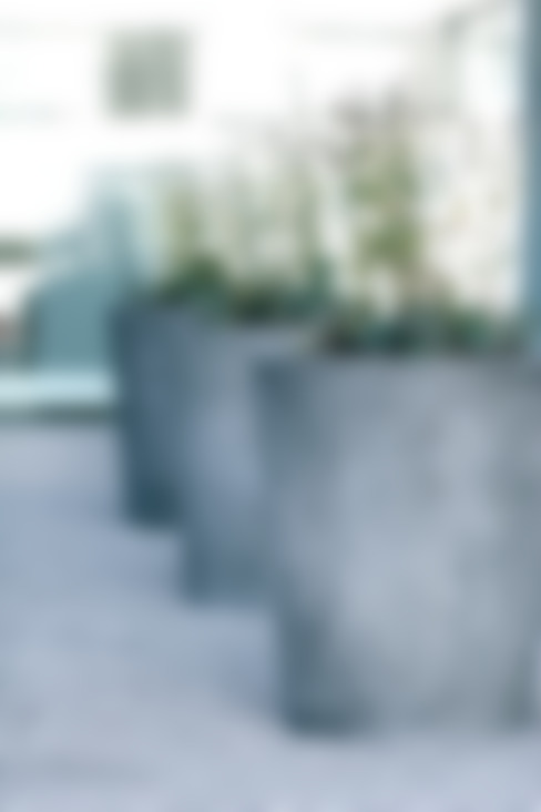 Varanda, alpendre e terraço  por Concrete Rudolph GmbH