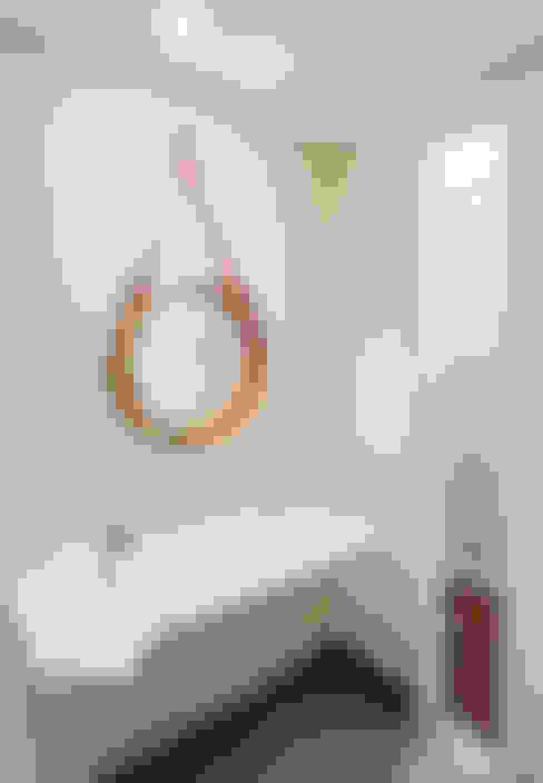 Casas de banho  por Cota Cero Interiorismo