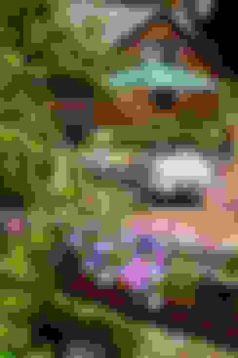 Jardins  por villa rosa