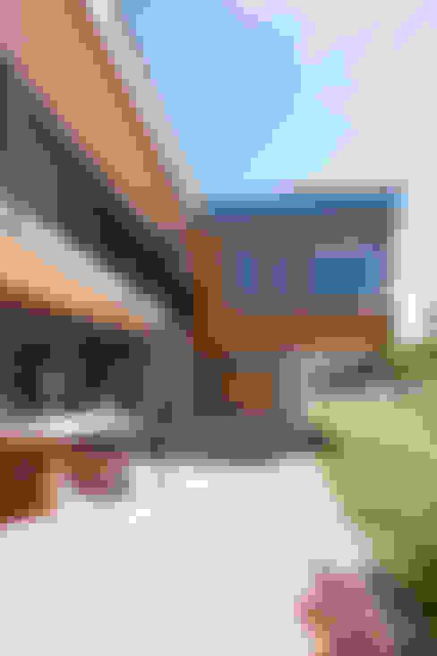 Terrazas de estilo  por in_design architektur