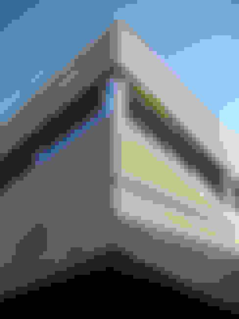 Houses by ESTUDIO GEYA