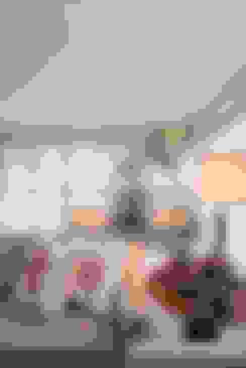 Lar de verão para unir a familia: Casas  por Actual Design
