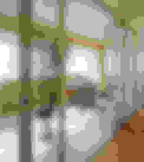 4階住居/プライベートリビング インナーテラス: UZUが手掛けたサンルームです。