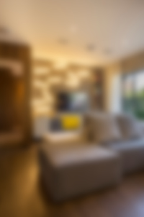 غرفة المعيشة تنفيذ Studiodwg Arquitetura e Interiores Ltda.
