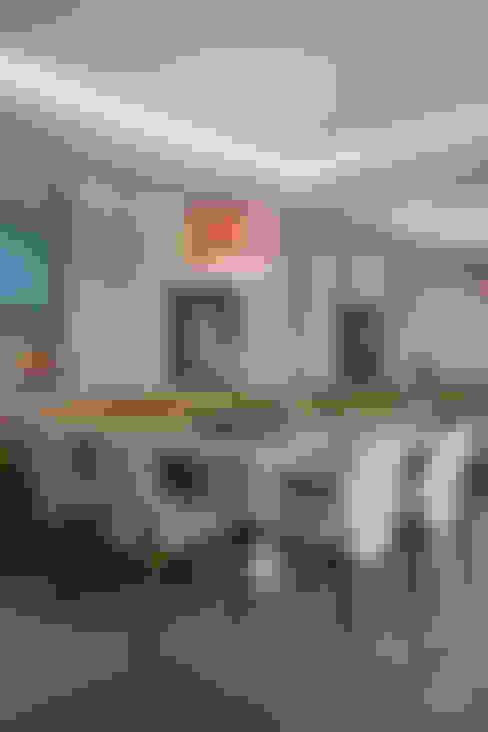 Apartamento Bravo: Salas de estar  por HB Interiores