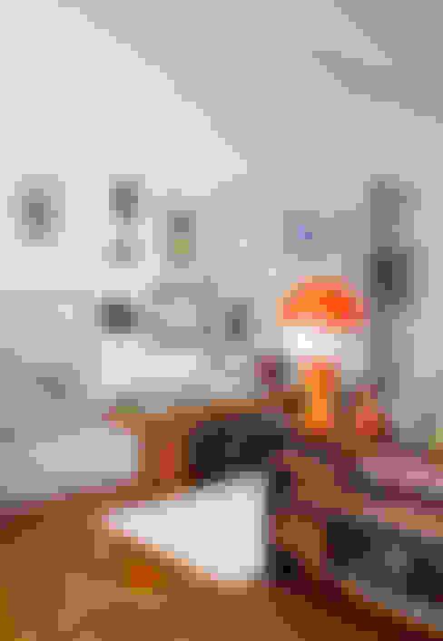 Apartamento Sabará: Sala de estar  por Zemel+ ARQUITETOS