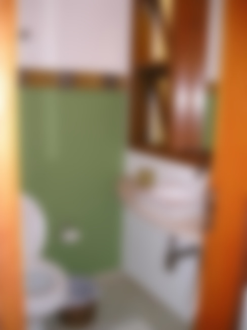Lavabo: Banheiros  por Metamorfose Arquitetura e Urbanismo