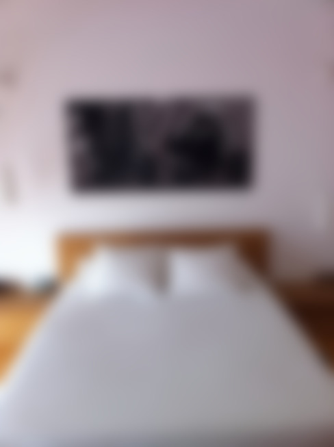Dormitorios de estilo  por SMMARQUITECTURA