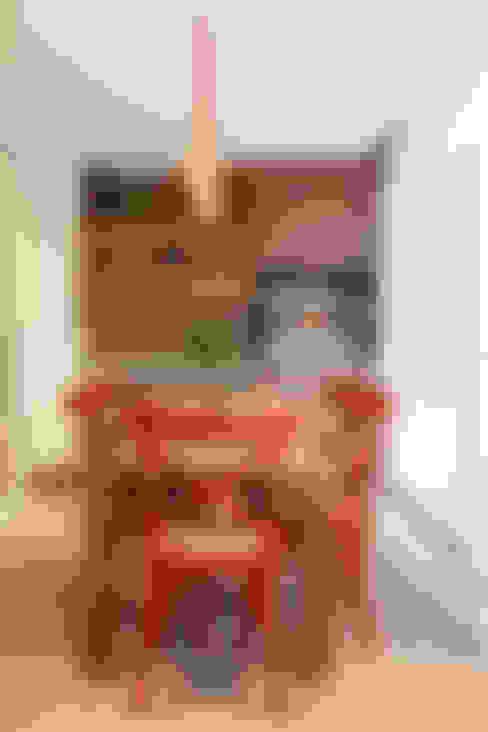 Apartamento na Pompeia, São Paulo: Terraços  por Liliana Zenaro Interiores
