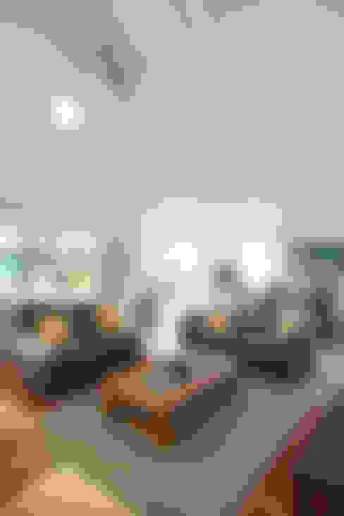 Salas de estar  por Estudio Claria