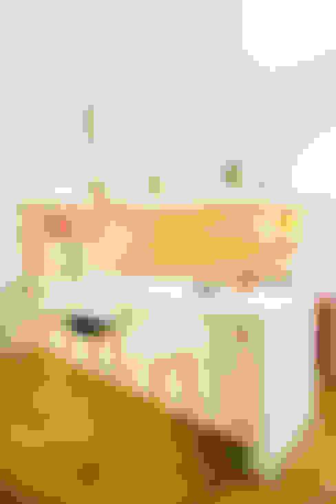 Projekty,  Kuchnia zaprojektowane przez Taller Estilo Arquitectura