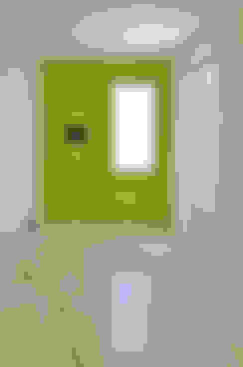 日並郷の家: 株式会社アトリエカレラが手掛けた寝室です。