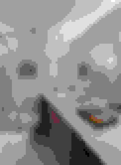 Cobertura - Pinheiros: Banheiros  por MANDRIL ARQUITETURA E INTERIORES