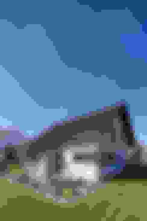 Casas unifamiliares de estilo  por FingerHaus GmbH - Bauunternehmen in Frankenberg (Eder)