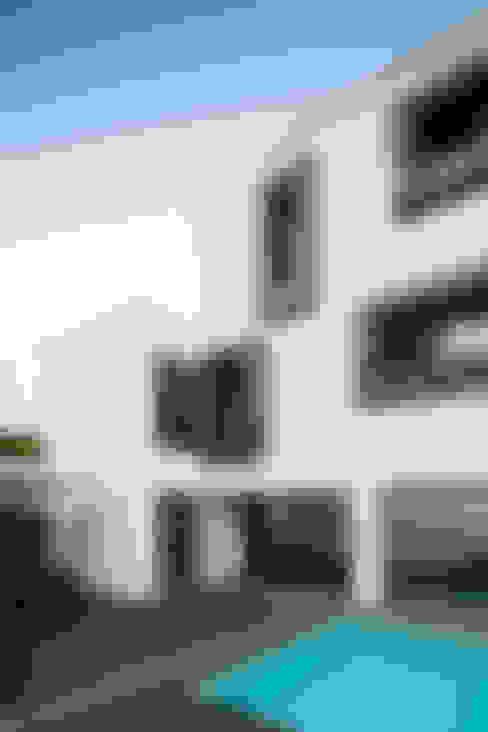 JPS Atelier - Arquitectura, Design e Engenharia의  주택