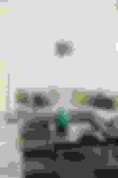 Salas / recibidores de estilo  por Dovela Interiorismo