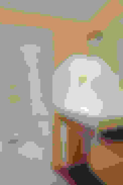 Baños de estilo  por senzanumerocivico