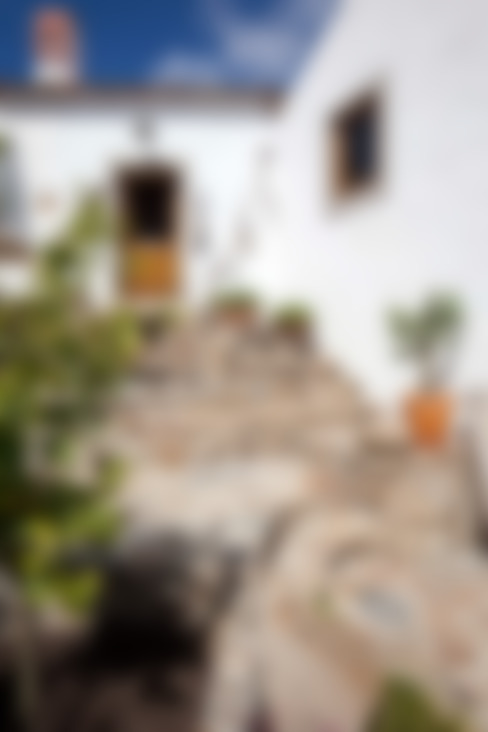 CASA EM FORMA DE ABRAÇO : Casas  por pedro quintela studio