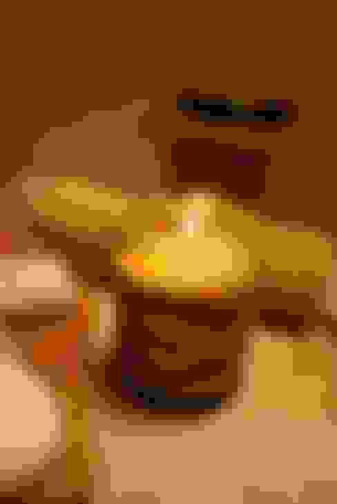 Vela-Masaje: Dormitorios de estilo  por protocolo criollo®