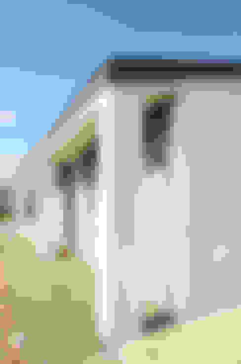บ้านและที่อยู่อาศัย by 로움 건축과 디자인