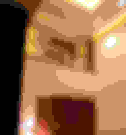 Salas / recibidores de estilo  por GRUPO VOLTA