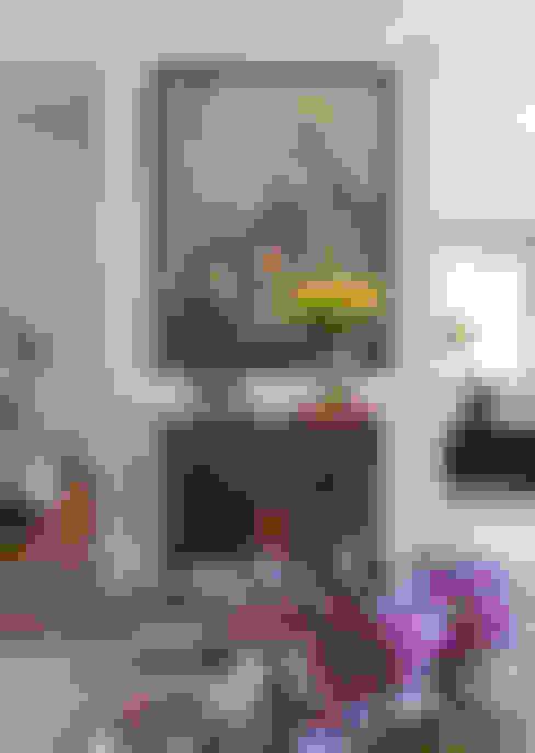 Casa Amarela: Salas de estar  por DIEGO REVOLLO ARQUITETURA S/S LTDA.