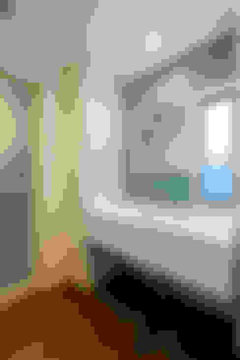 洗面室: Unico design一級建築士事務所が手掛けた浴室です。