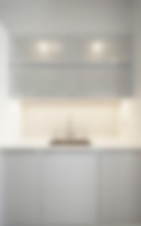Downtown White on White Apartment:  Kitchen by Andrew Mikhael Architect