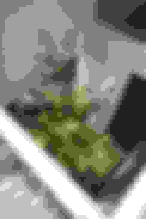 空と暮らす家: 設計事務所アーキプレイスが手掛けたテラス・ベランダです。