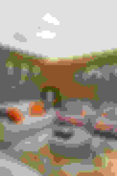 Apartamento de 50m² - Antes e Depois: Salas de estar  por Vanessa De Mani