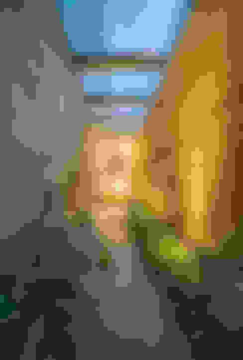 Pasillos y hall de entrada de estilo  por Lopez Duplan Arquitectos
