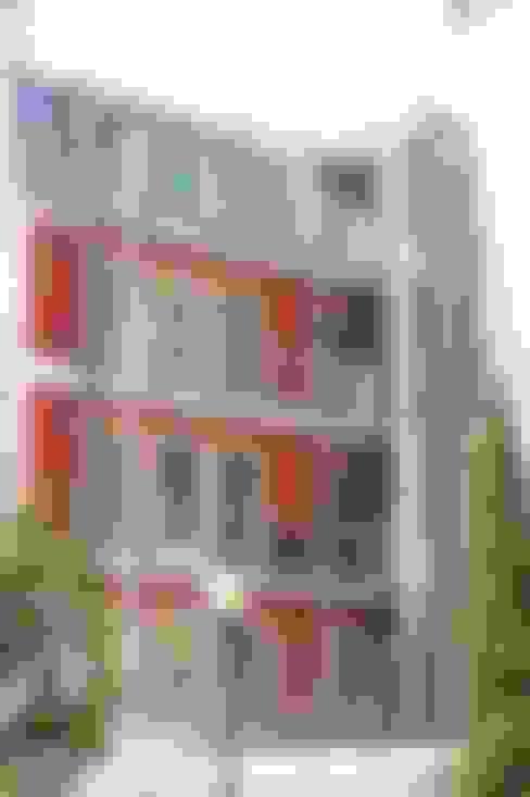 Alçado tardoz do Alcantara Red Houses: Casas  por QFProjectbuilding, Unipessoal Lda