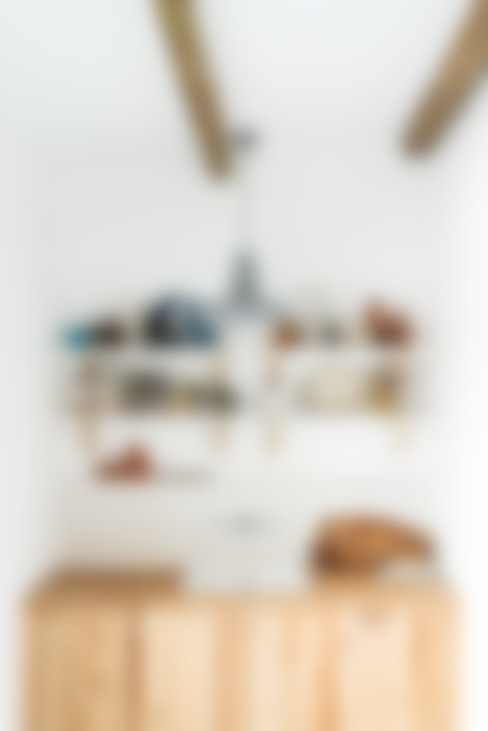 Pormenor da zona de copa: Cozinhas  por Arkstudio