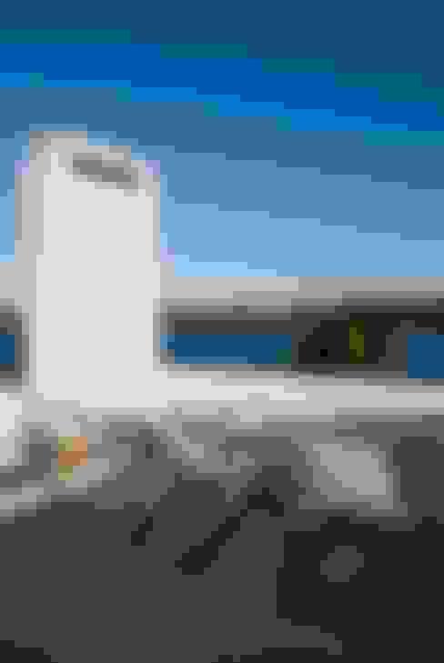 Terraza al lago: Terrazas de estilo  por CIBA ARQUITECTURA