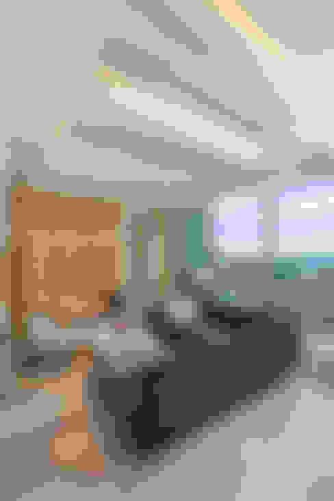 Salas / recibidores de estilo  por Bloque B Arquitectos