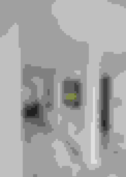 Remodelación Departamento Las Condes: Livings de estilo  por Grupo E Arquitectura y construcción