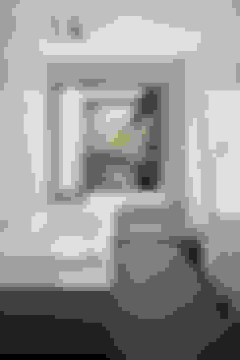 Baños de estilo  por atelier137 ARCHITECTURAL DESIGN OFFICE