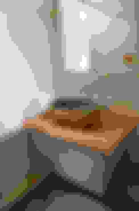 【舊屋翻新】36年透天屋宅改造設計案:  浴室 by Gavin室內裝修設計
