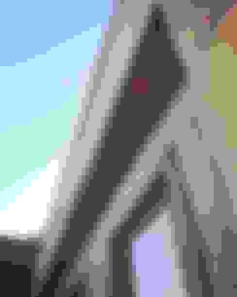 Fachada de piedra reconstituida térmica. Vivienda Lt37 Premium 115m2 Fundo Loreto.: Casas unifamiliares de estilo  por Territorio Arquitectura y Construccion - La Serena