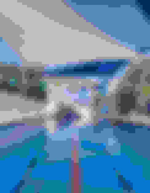 庭院泳池 by Daniel Cota Arquitectura | Despacho de arquitectos | Cancún